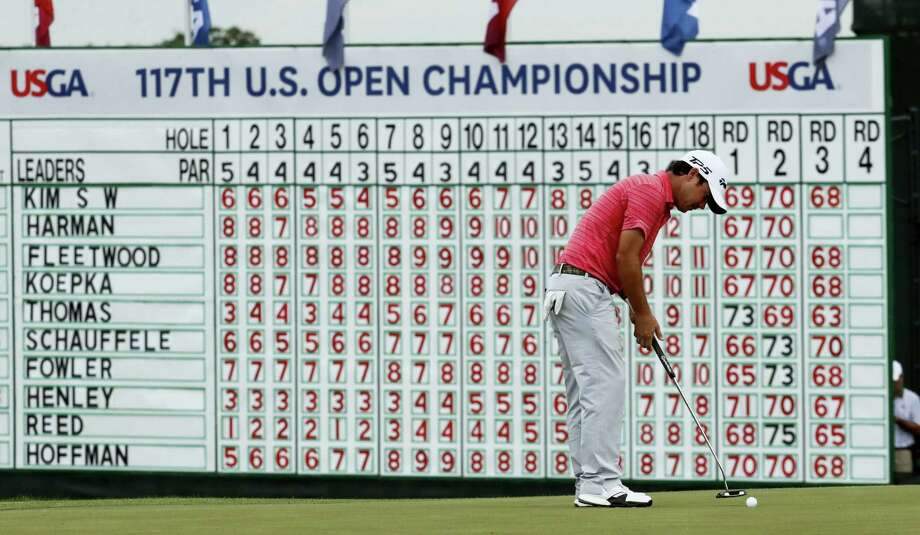 Brian Harman putts on the 18th hole during the third round of the U.S. Open. Photo: The Associated Press File Photo   / Copyright 2017 The Associated Press. All rights reserved.