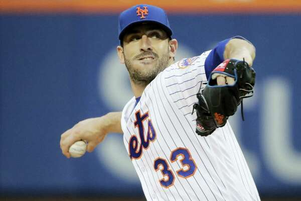 New York Mets' Matt Harvey delivers a pitch during the first inning against the San Diego Padres Tuesday.