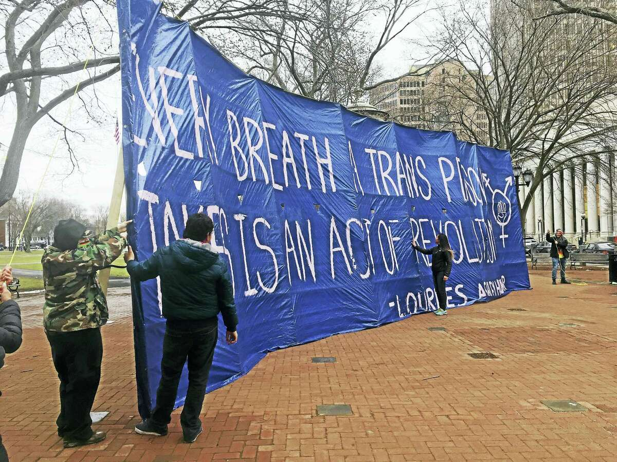 """A pro-transgender rights rally was held Sunday on the New Haven Green in anticipation of the expected arrival of an anti-transgender """"Free Speech Bus."""""""