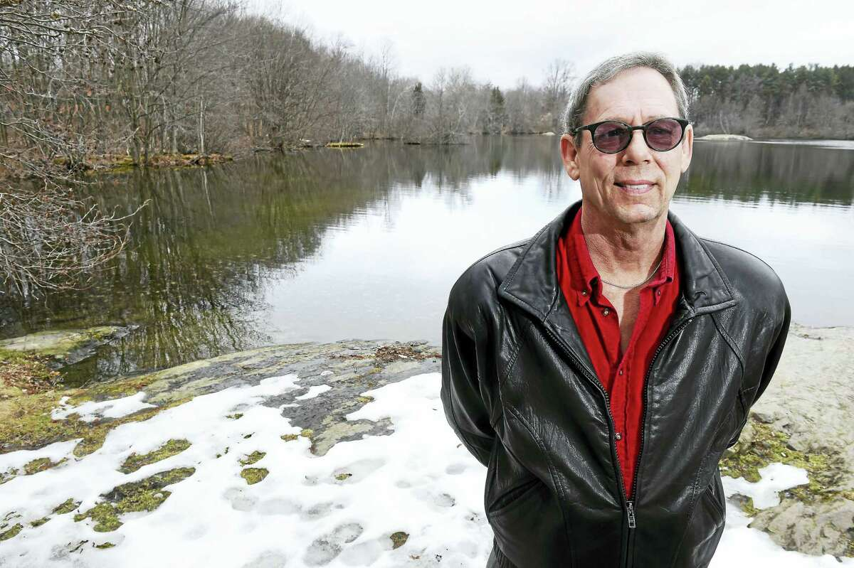 John O'Rourke of Milford pauses at Mondo Ponds in Milford on Friday, where he rescued a boy this winter who had fallen through the ice.