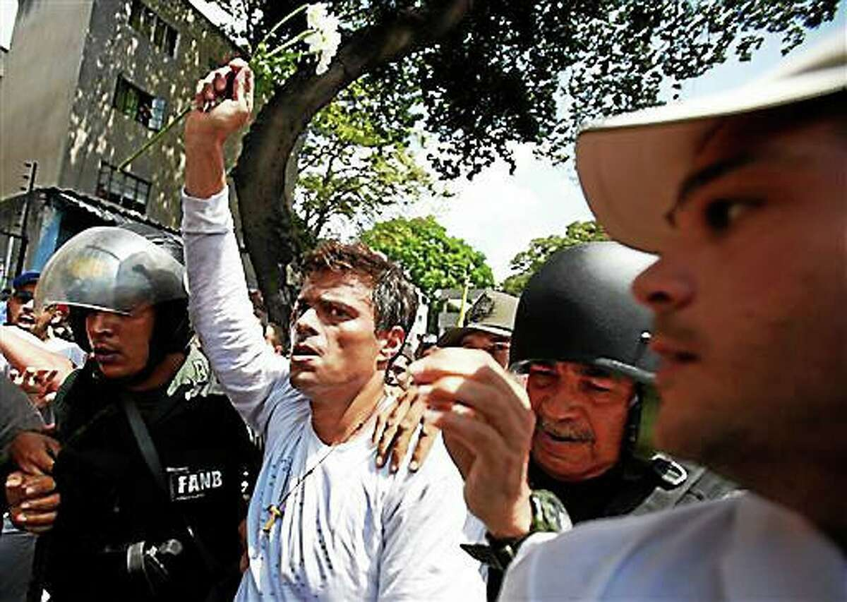 Opposition leader Leopoldo Lopez is delivered to the National Guard in Caracas, Tuesday, February 18, 2014, to face a process for his alleged responsibility for the violent events of the last week. (AP Photo/Alexander Cegarra)