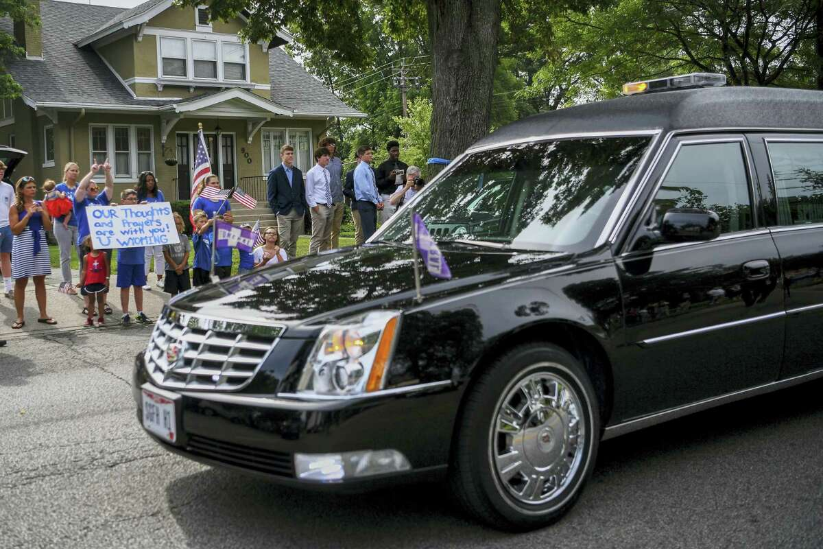 Mourners line the street after the funeral of Otto Warmbier as the hearse passes, Thursday, June 22, 2017, in Wyoming, Ohio. Warmbier, a 22-year-old University of Virginia undergraduate student who was sentenced in March 2016 to 15 years in prison with hard labor in North Korea, died this week, days after returning to the United States.