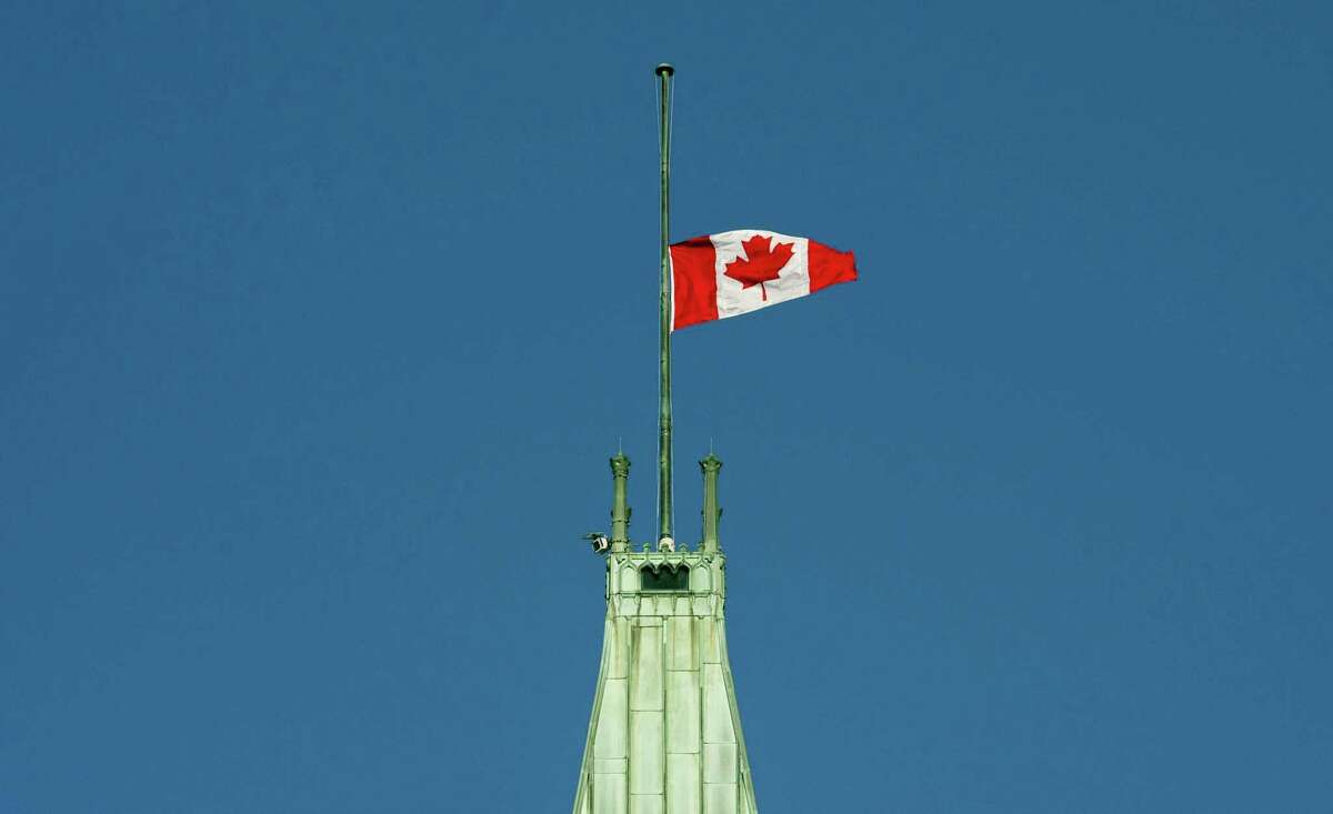 The flag flies at half-mast on the Peace tower Monday in Ottawa. It was announced Monday that the flag would fly at half-mast in memory of the victims of the Quebec City shooting.