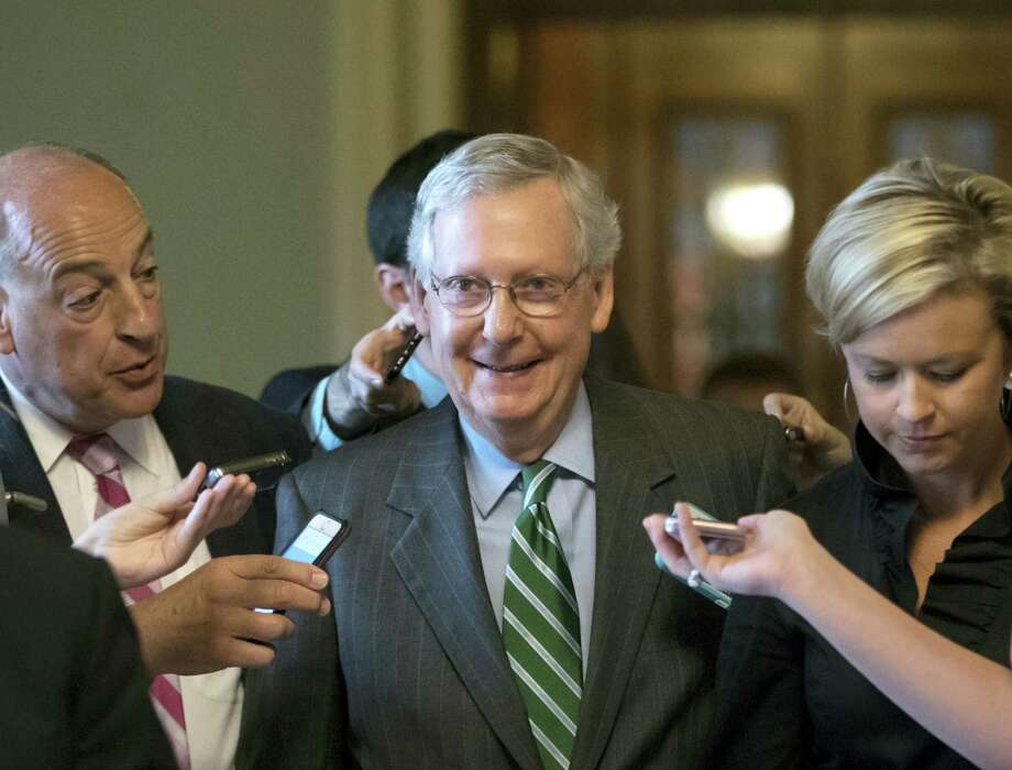 Senate Majority leader Mitch McConnell smiles as he leaves the chamber after announcing the release of the Republicans' health care bill, which represents the party's long-awaited attempt to scuttle much of President Barack Obama's Affordable Care Act, at the Capitol in Washington, Thursday, June 22, 2017. Photo: AP Photo/J. Scott Applewhite    / Copyright 2017 The Associated Press. All rights reserved.