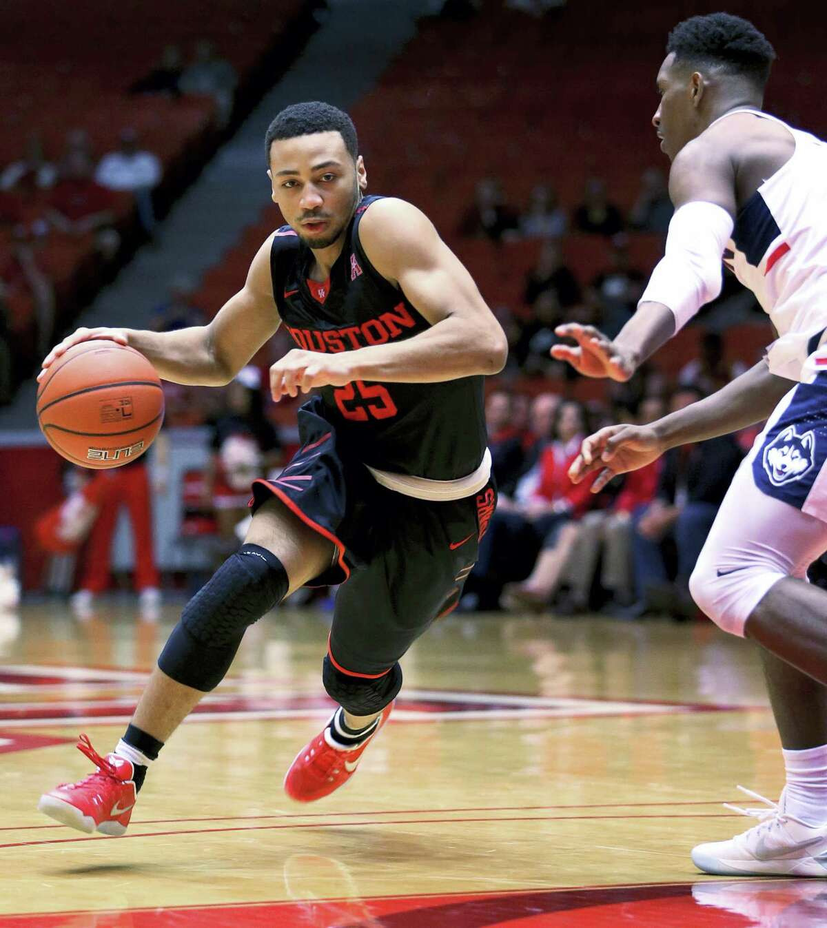Houston guard Galen Robinson Jr. (25) drives toward the basket during the first half of an NCAA college basketball game against UConn, Wednesday in Houston.