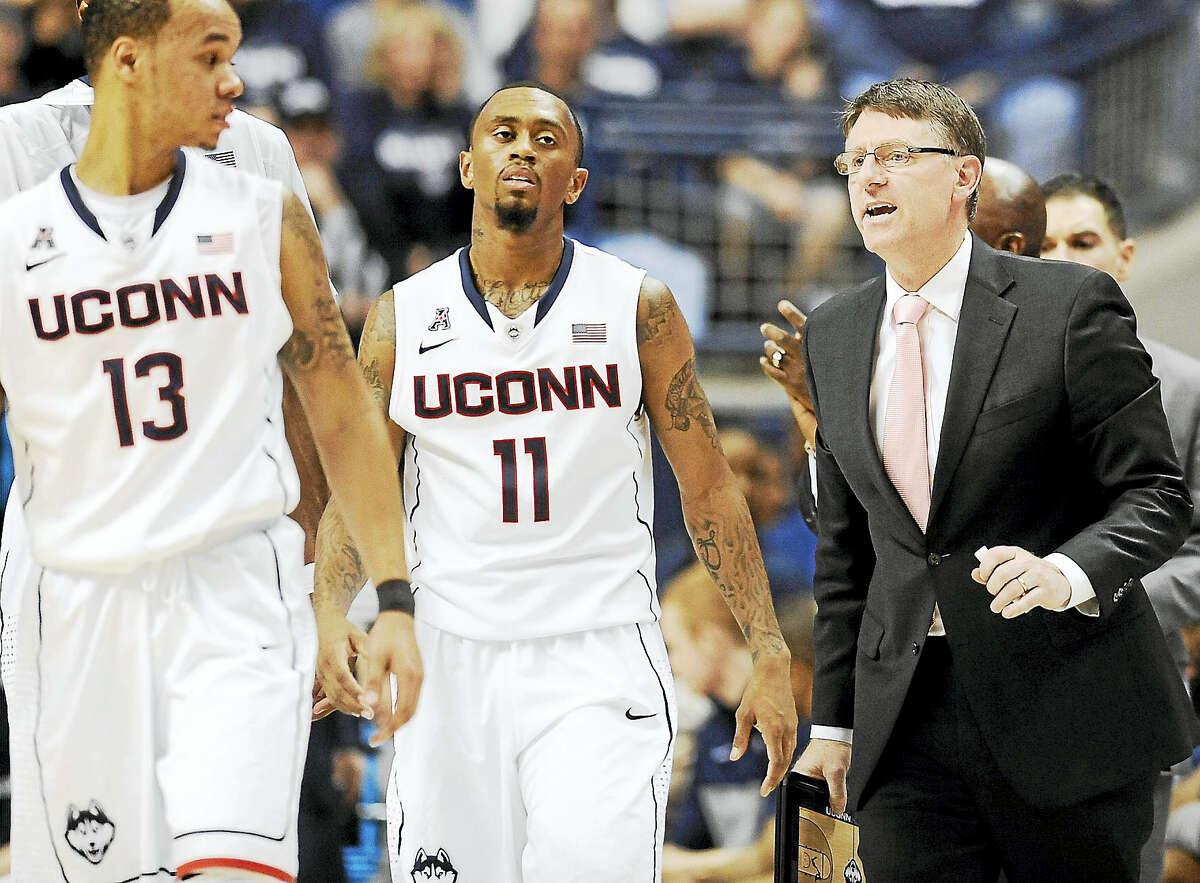 UConn associate head coach Glen Miller, right, has left the program.