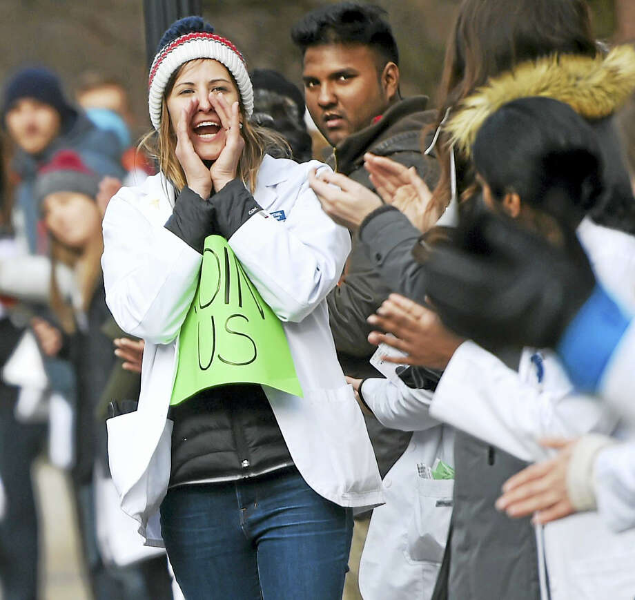 Yale University medical student Karri Weisenthal shouts out instructions as medical students and others demonstrate at Yale's Sterling Hall of Medicine in New Haven Connecticut Monday afternoon against repeal of the Affordable Care Act. Photo: Peter Hvizdak — New Haven Register    / ©2017 Peter Hvizdak