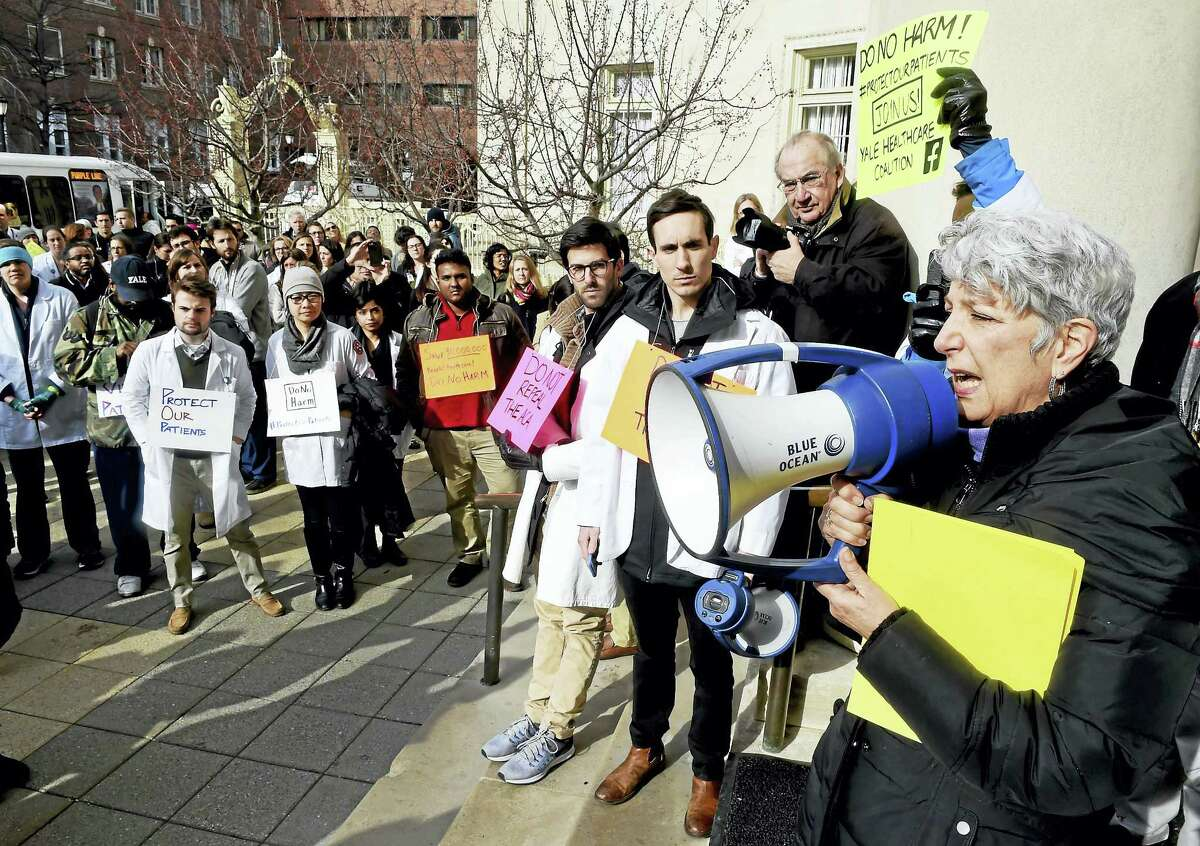 Yale School of Nursing professor Andree DeLisser, right, speaks at a rally Monday in New Haven against the repeal of the Affordable Care Act.
