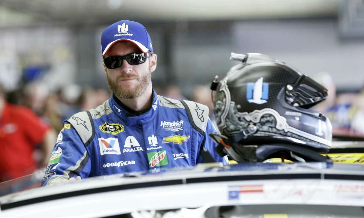 Dale Earnhardt Jr. waits in the garage prior to a practice.