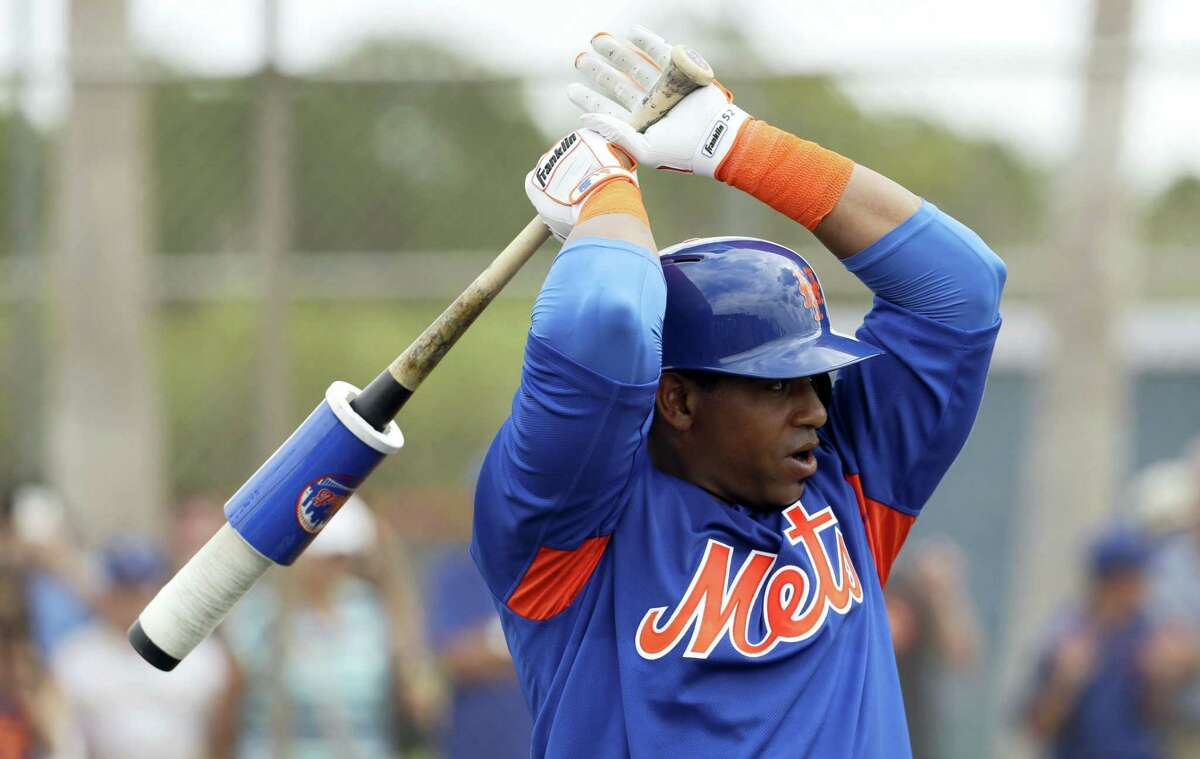 Mets left fielder Yoenis Cespedes gets loose at a spring training workout in Port St. Lucie, Fla.