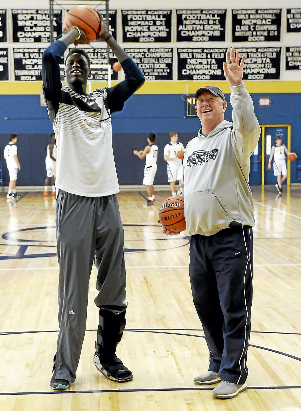 Chol Marial, left, receives instruction from Cheshire Academy coach Kevin Kehoe.