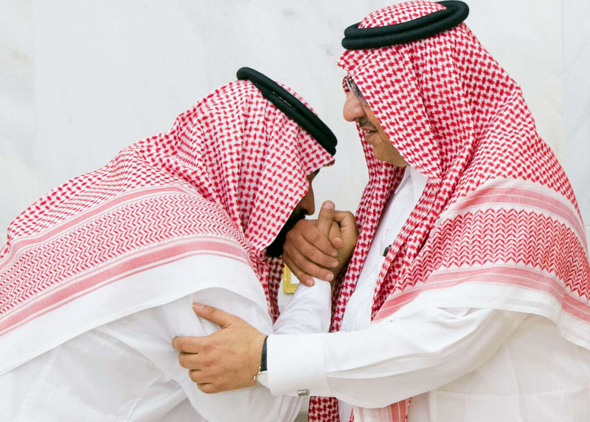 In this Wednesday, June 21 , 2017 photo released by Al-Ekhbariya, Mohammed bin Salman, newly appointed as crown prince, left, kisses the hand of Prince Mohammed bin Nayef at royal palace in Mecca, Saudi Arabia. Saudi Arabia's King Salman on Wednesday appointed his 31-year-old son Mohammed bin Salman as crown prince, placing him first-in-line to the throne and removing the country's counterterrorism czar and a figure well-known to Washington from the line of succession.