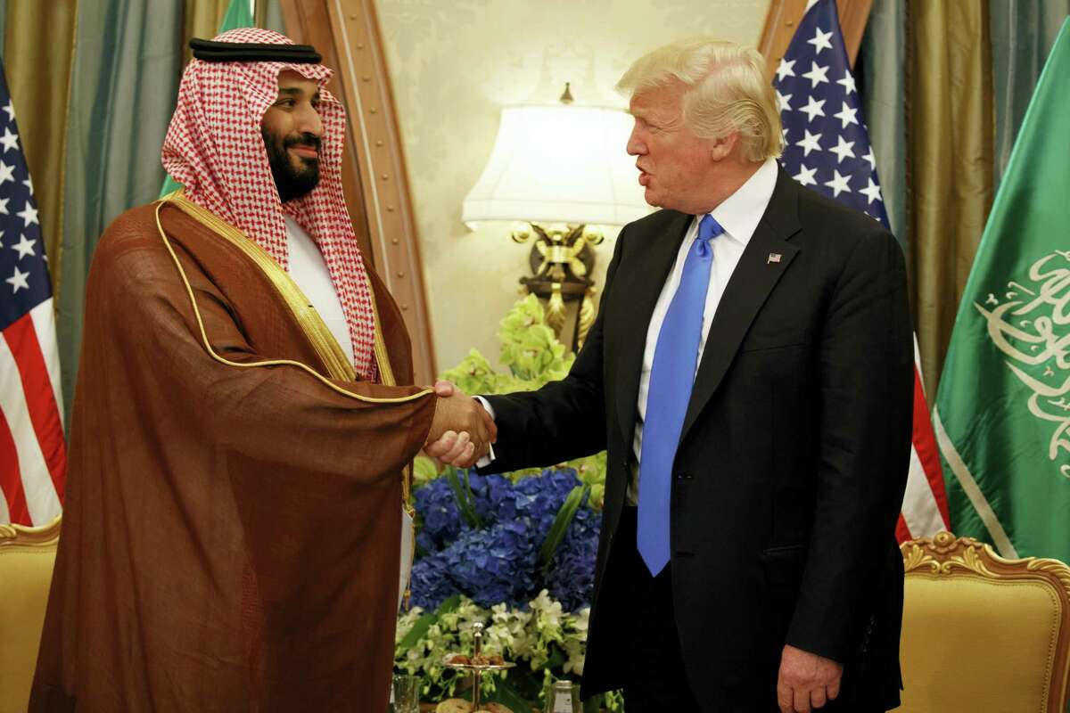 FILE- In this Saturday, May 20, 2017 file photo, President Donald Trump shakes hands with Saudi Deputy Crown Prince and Defense Minister Mohammed bin Salman during a bilateral meeting, in Riyadh. Trump's son-in-law Jared Kushner and Saudi Arabia's newest heir to the throne Mohammed bin Salman, or MBS as he is known, have skyrocketed to power and been entrusted with a wealth of responsibilities and wide-ranging duties, even though neither had the experience or that comes with years of government service. (AP Photo/Evan Vucci, File)