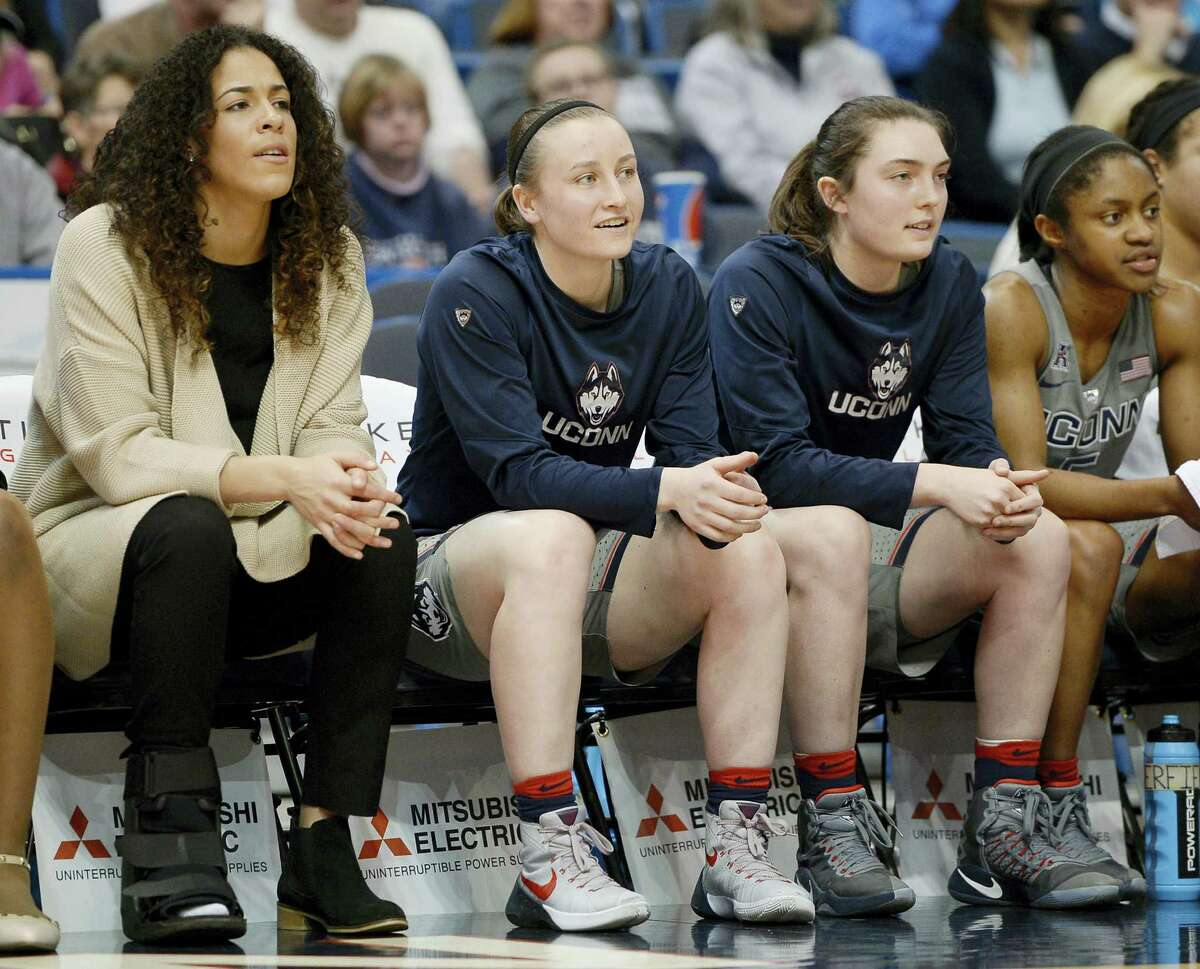 Tierney Lawlor, second from left, sits on the bench with teammates, from left, Kia Nurse, Molly Bent and Crystal Dangerfield.