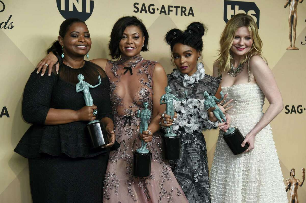 """Octavia Spencer, from left, Taraji P. Henson, Janelle Monae, and Kirsten Dunst pose in the press room with the award for outstanding performance by a cast in a motion picture for """"Hidden Figures"""" at the 23rd annual Screen Actors Guild Awards at the Shrine Auditorium & Expo Hall on Sunday, Jan. 29, 2017, in Los Angeles."""