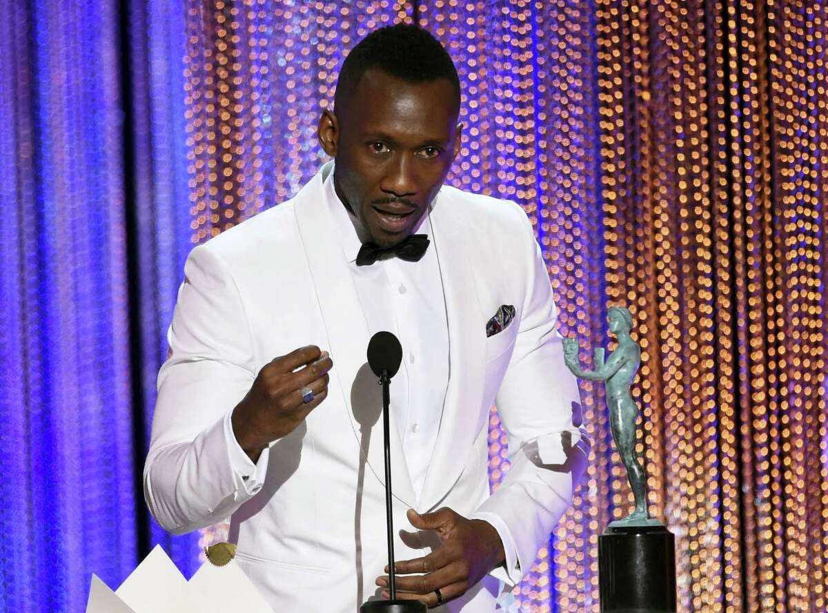 """Mahershala Ali accepts the award for outstanding performance by a male actor in a supporting role for """"Moonlight"""" at the 23rd annual Screen Actors Guild Awards at the Shrine Auditorium & Expo Hall on Sunday, Jan. 29, 2017, in Los Angeles. (Photo by Chris Pizzello/Invision/AP)"""