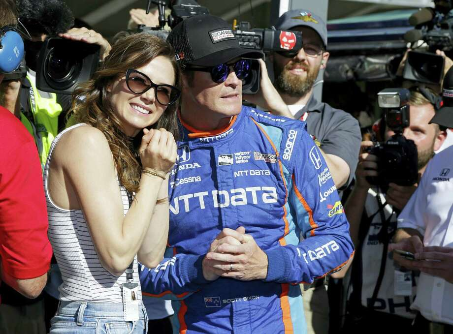 Scott Dixon, of New Zealand, watches with his wife, Emma, the final attempt to knock him off the pole during qualifications for the Indianapolis 500 IndyCar auto race at Indianapolis Motor Speedway on May 21, 2017 in Indianapolis. Photo: AP Photo — Michael Conroy   / Copyright 2017 The Associated Press. All rights reserved.