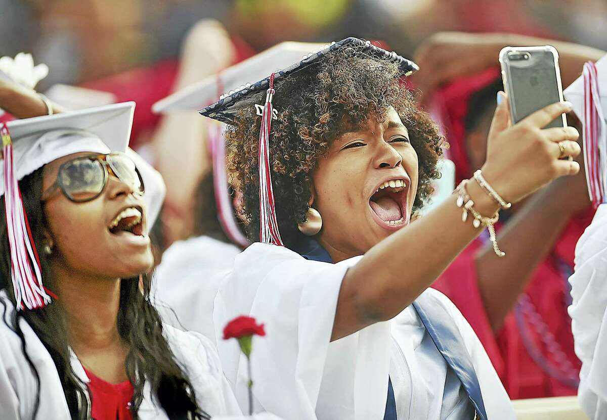 Frances Shadai Rosario Frias takes a video after the class of 2017 received their diplomas at Wilbur Cross High School graduation Thursday in New Haven. Frias will enter the Navy after graduation.