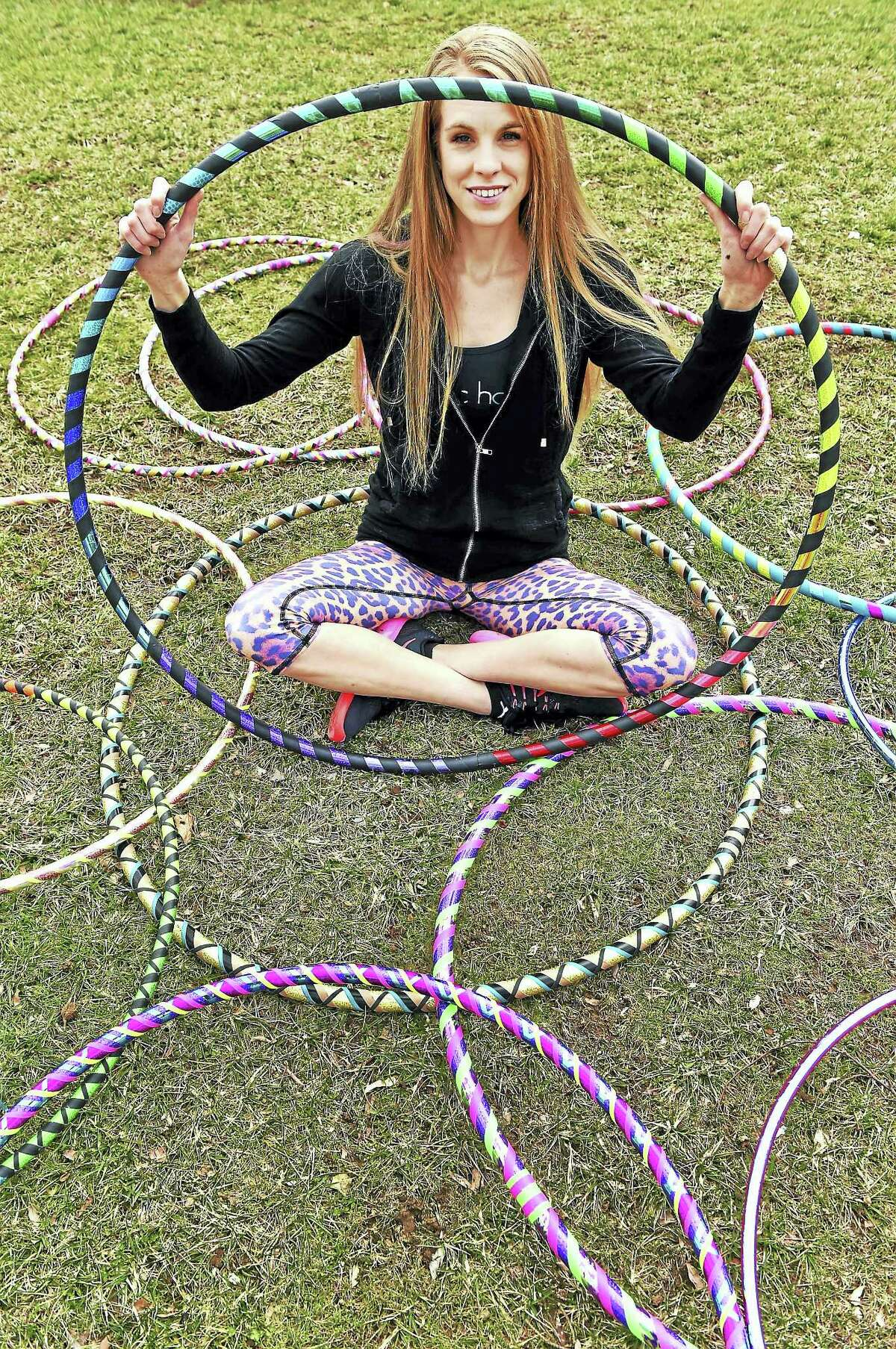 Peter Hvizdak — New Haven RegisterKailey Mitchell of Hipnotic Hoopla of North Branford with her hula hoops on the Branford Green. Mitchell makes custom hula hoops, demonstrates and performs with the hula hoop at a variety of events and gives fitness classes along the Shoreline using the hula hoop.