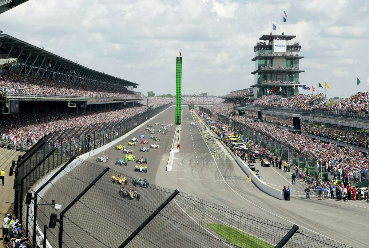 The field rolls into the first turn during the 100th running of the Indianapolis 500 last year.