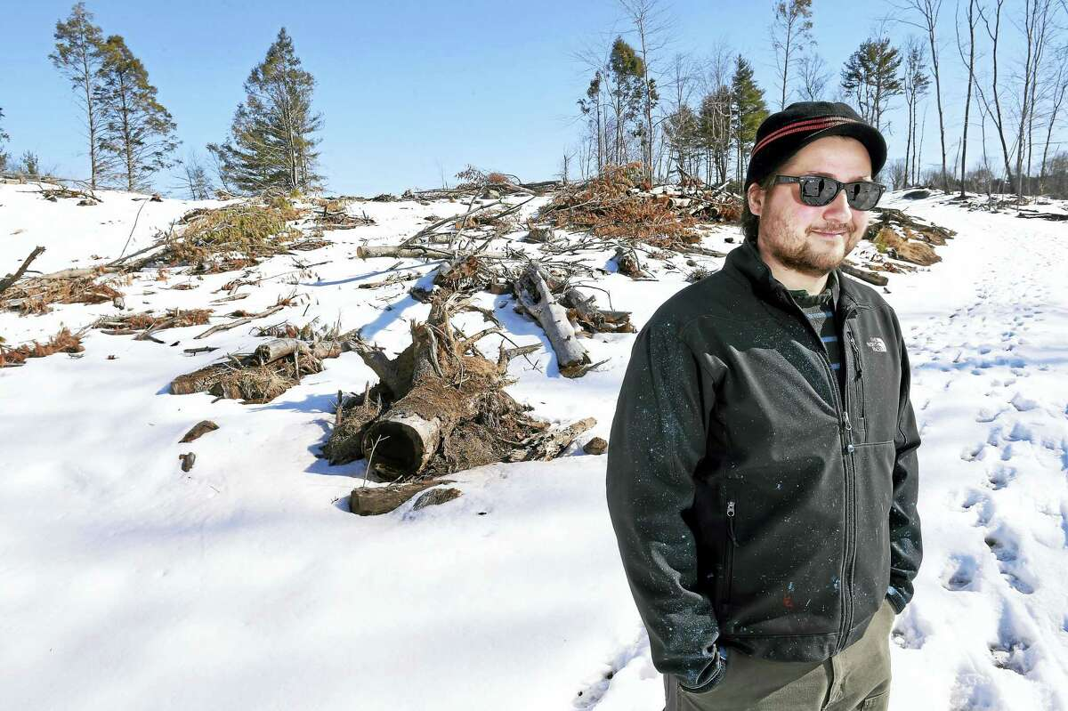 (Arnold Gold-New Haven Register) Regional Water Authority forester Alexander Amendola is photographed on 3/20/2017 in an area of the Maltby Lake Recreation Area where trees were cleared because of an invasive beetle in West Haven.