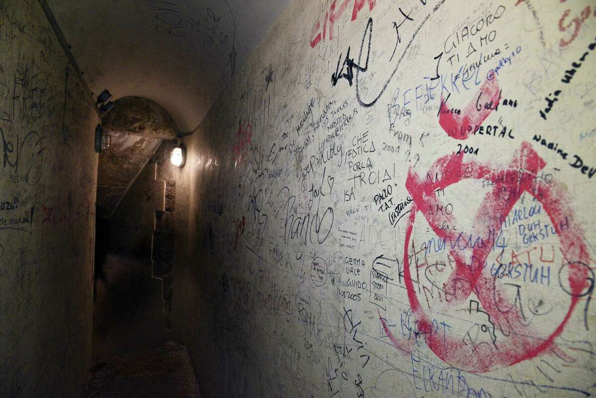 Graffiti is seen along the walls of the stairway of the dome of Santa Maria del Fiore Cathedral in Florence, Italy, in this Jan. 24, 2017, photo made available on Thursday, Feb. 23, 2017. Florence's famed Duomo is cleaning up its act, removing centuries of graffiti from the cathedral dome interior and letting new visitors leave their mark digitally instead.