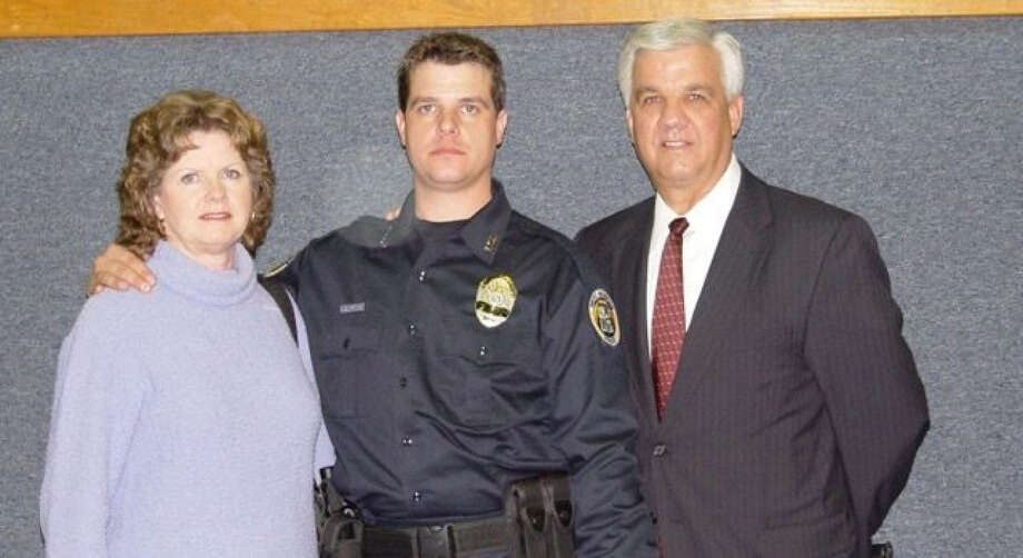 Brandon Paudert with his parents at his graduation from the police academy in Arkansas in 2003. (Photo courtesy of Bob Paudert) Photo: Handout / Handout