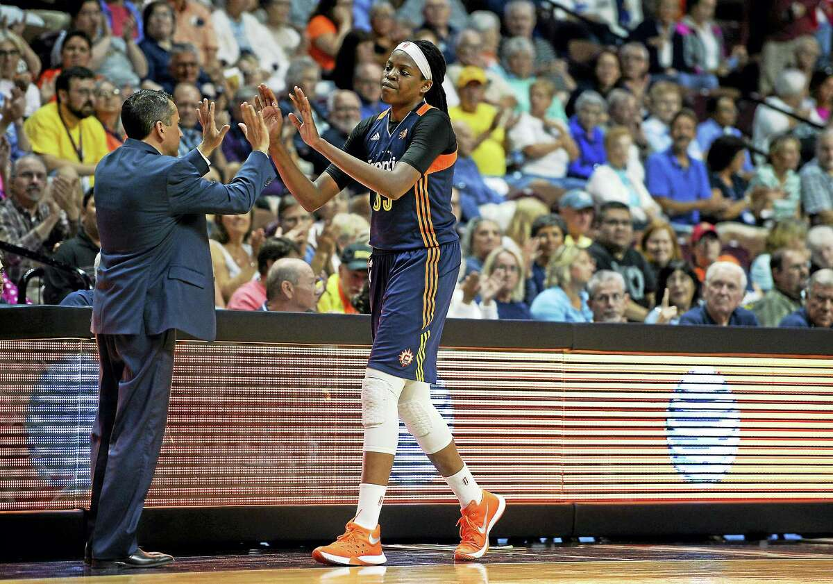 The Sun's Jonquel Jones, right, is currently the leading rebounder in the WNBA.
