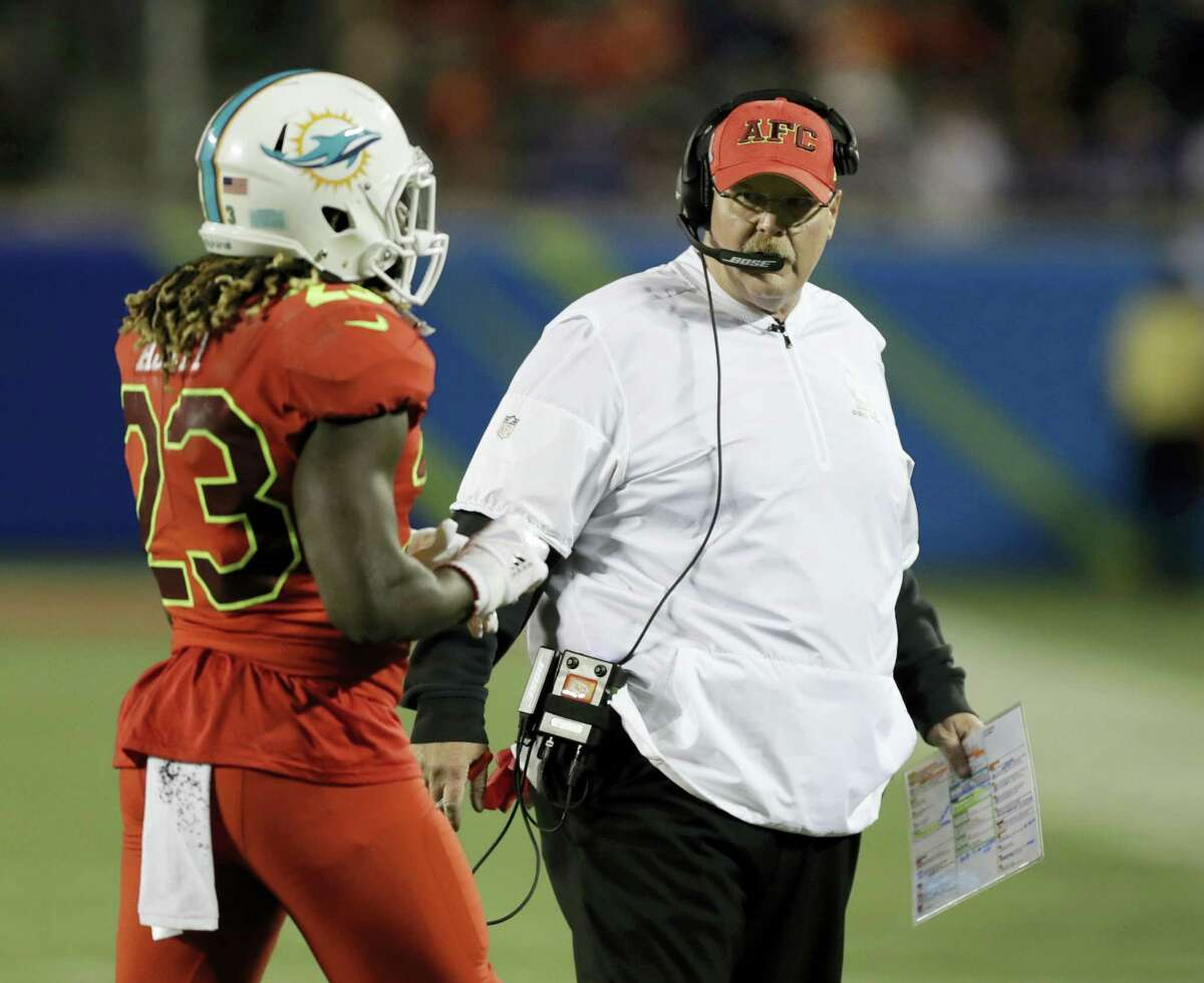 AFC head coach Andy Reid, of the Kansas City Chiefs, talks to running back Jay Ajayi during the Pro Bowl on Sunday.