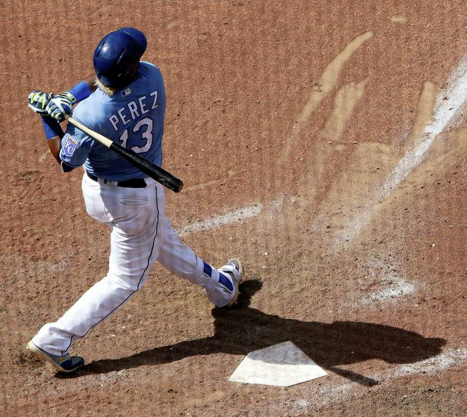 Kansas City Royals' Salvador Perez watches his grand slam during the eighth inning of the team's baseball game against the Boston Red Sox on Wednesday, in Kansas City, Mo. The Royals won 6-4. Photo: Charlie Riedel - The Associated Press   / Copyright 2017 The Associated Press. All rights reserved.