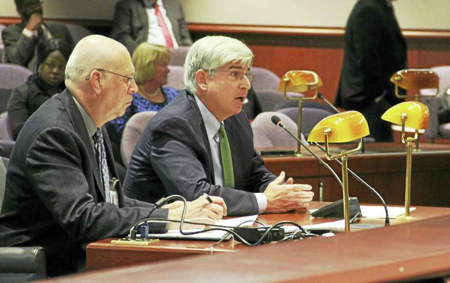 Connecticut Chief Medical Examiner Dr. James Gill, right, testifies during a General Assembly Appropriations Committee hearing Thursday in Hartford. Seated next to Gill is Lincoln Gordon, the medical examiner's office fiscal manager. Photo: Esteban L. Hernandez — New Haven Register