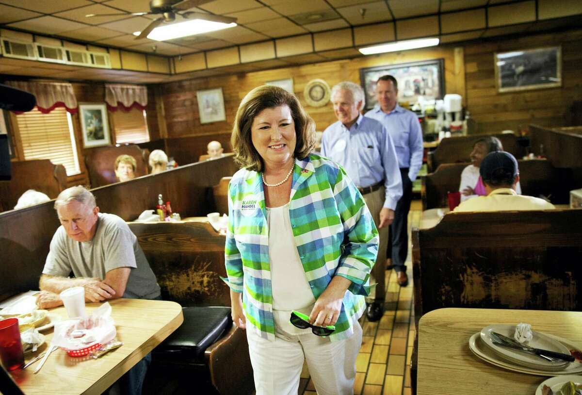 AP Photo/David Goldman Karen Handel, Republican candidate for Georgia's 6th congressional district greets diners during a campaign stop at Old Hickory House in Tucker, Ga., Monday, June 19, 2017. The race between Handel and Democrat Jon Ossoff is seen as a significant political test for the new Trump Administration. The district traditionally goes Republican, but most consider the race too close to call as voters head to the polls on Tuesday.
