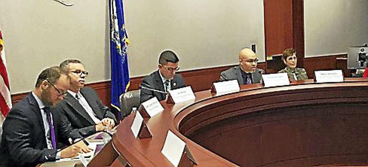 Emmauel Adero discusses his report at the Legislative Office Building