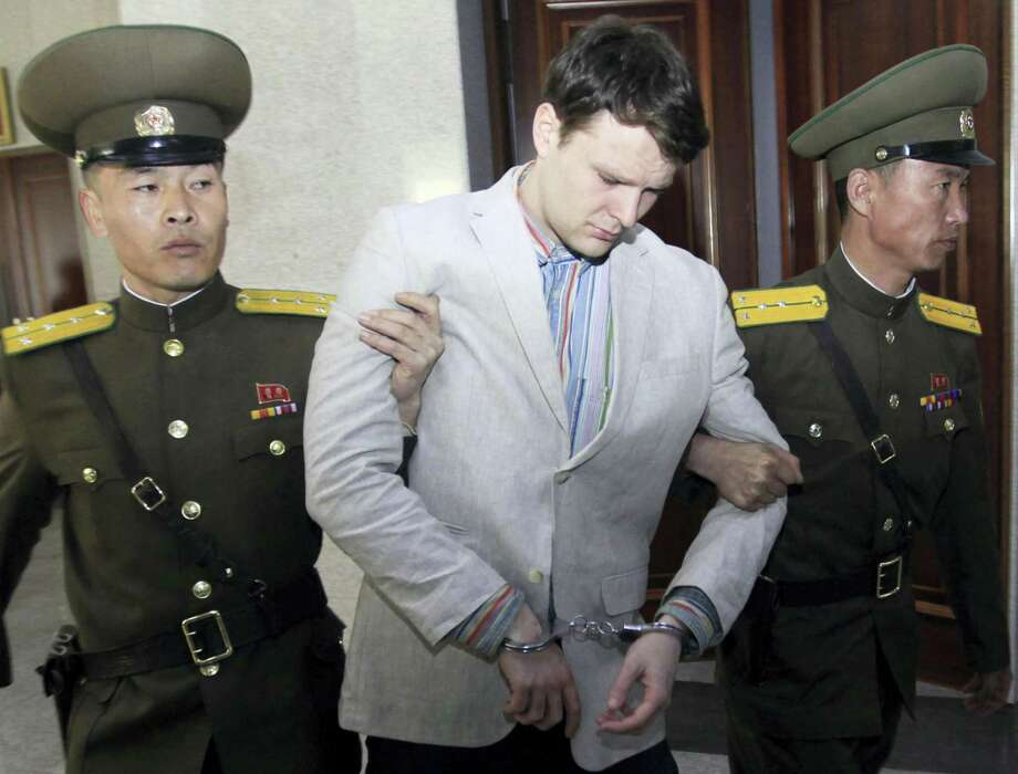 In this March 16, 2016, file photo, American student Otto Warmbier, center, is escorted at the Supreme Court in Pyongyang, North Korea. The death last week of American student Warmbier, who fell into a coma after being arrested in North Korea, has raised questions about whether his tour agency was adequately prepared for its trips into the hard-line communist state. The Young Pioneer Tours agency built up a business attracting young travelers with cut-rate, hard-partying adventures into one of the world's most isolated countries. Photo: AP Photo/Jon Chol Jin, File    / Copyright 2017 The Associated Press. All rights reserved.