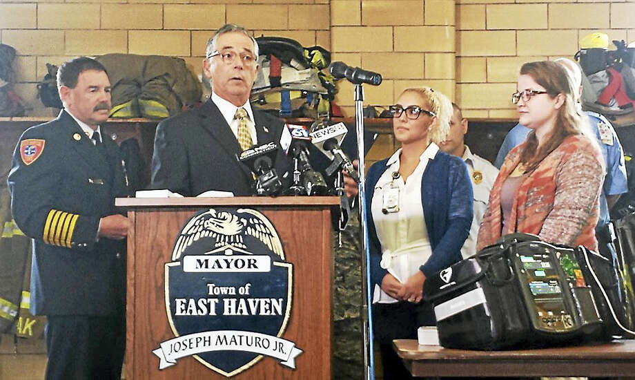 East Haven Mayor Joseph Maturo Jr. awards Tariana Ortega and Christine Fitzgerald with Certificates of Recognition Thursday for performing lifesaving CPR on a woman at Chili's Restaurant Bar & Grill in January. Photo: Sam Norton — New Haven Register