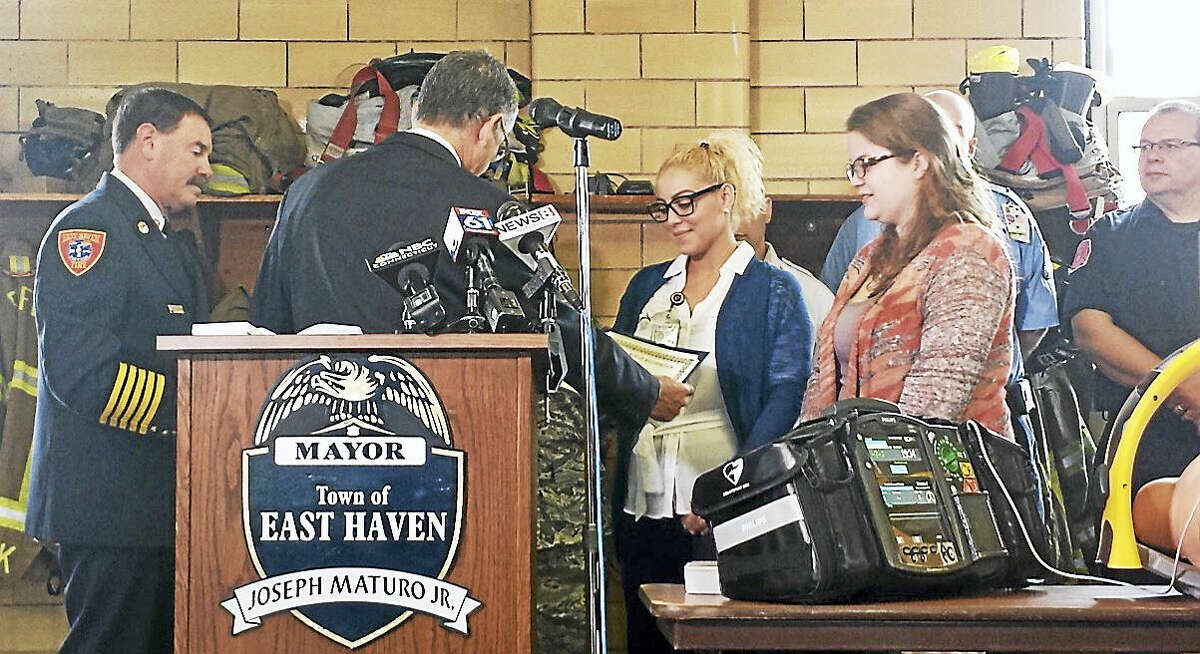 Mayor Joseph Maturo Jr. awards Tariana Ortega and Christine Fitzgerald with Certificates of Recognition Thursday for performing lifesaving CPR on a woman at Chili's Restaurant Bar & Grill in January.