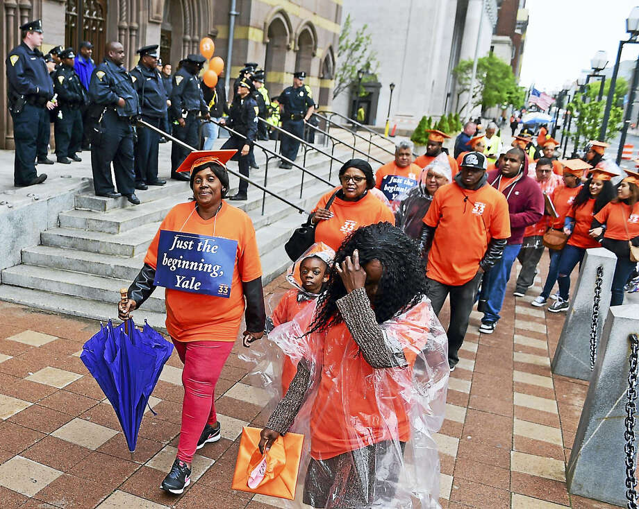 Supporters of Local 33 Unite Here walk past a contingent of approximately 20 New Haven police officers on the steps of New Haven City Hall Monday. Photo: Peter Hvizdak — New Haven Register   / Peter Hvizdak