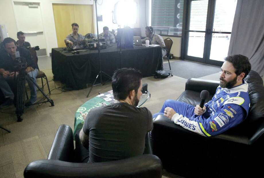 Jimmie Johnson, right, answers questions during an interview at NASCAR Daytona 500 media day at Daytona International Speedway on Feb. 22, 2017 in Daytona Beach, Fla. Photo: AP Photo/John Raoux   / Copyright 2017 The Associated Press. All rights reserved.