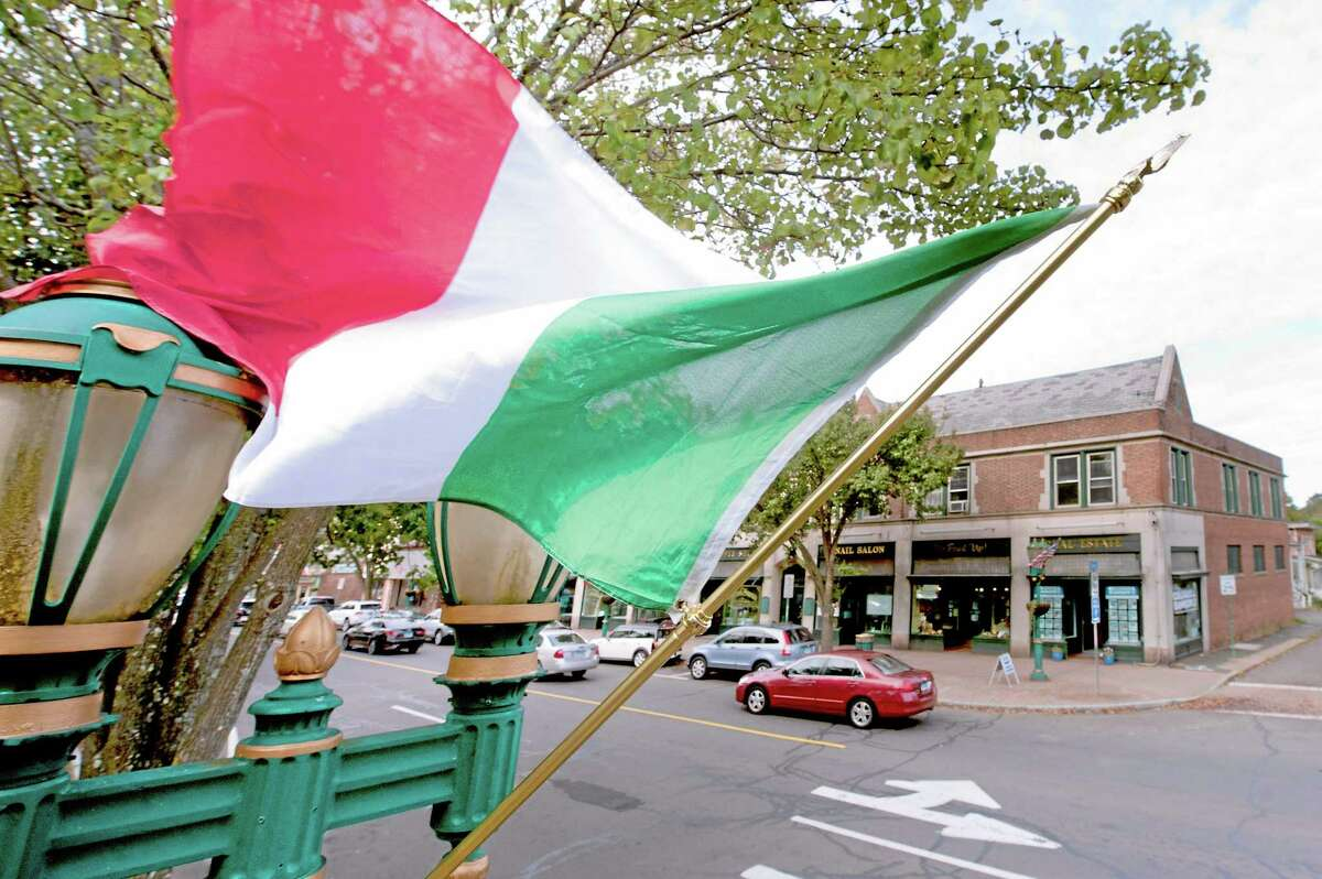 The Italian flag flies above the Branford Green to announce the town holding the 2013 Columbus Day parade.