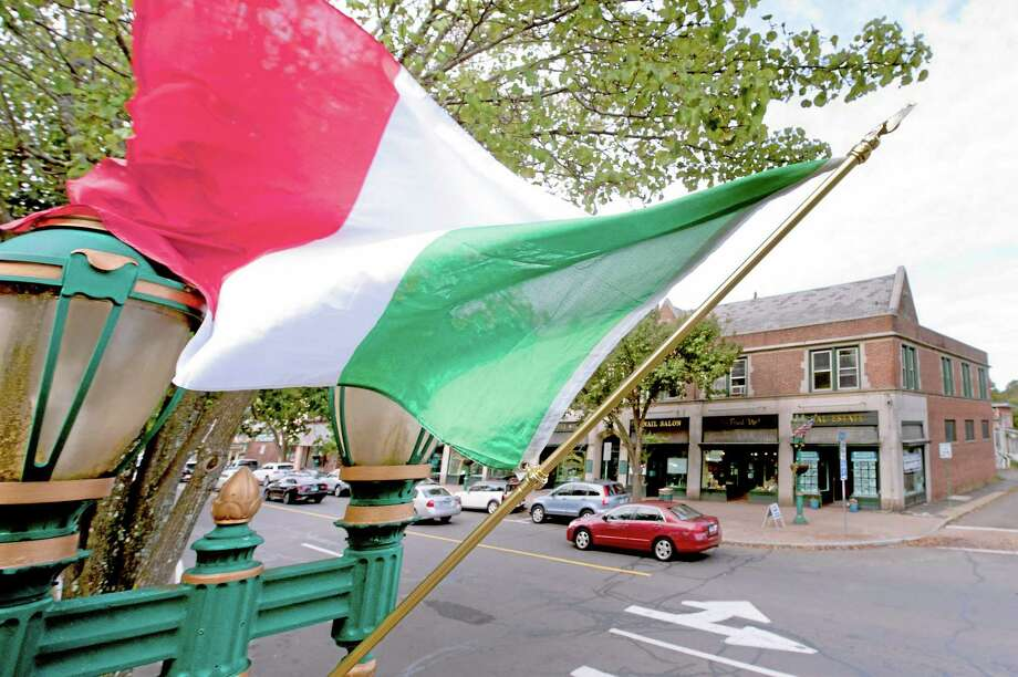 The Italian flag flies above the Branford Green to announce the town holding the 2013 Columbus Day parade. Photo: File Photo
