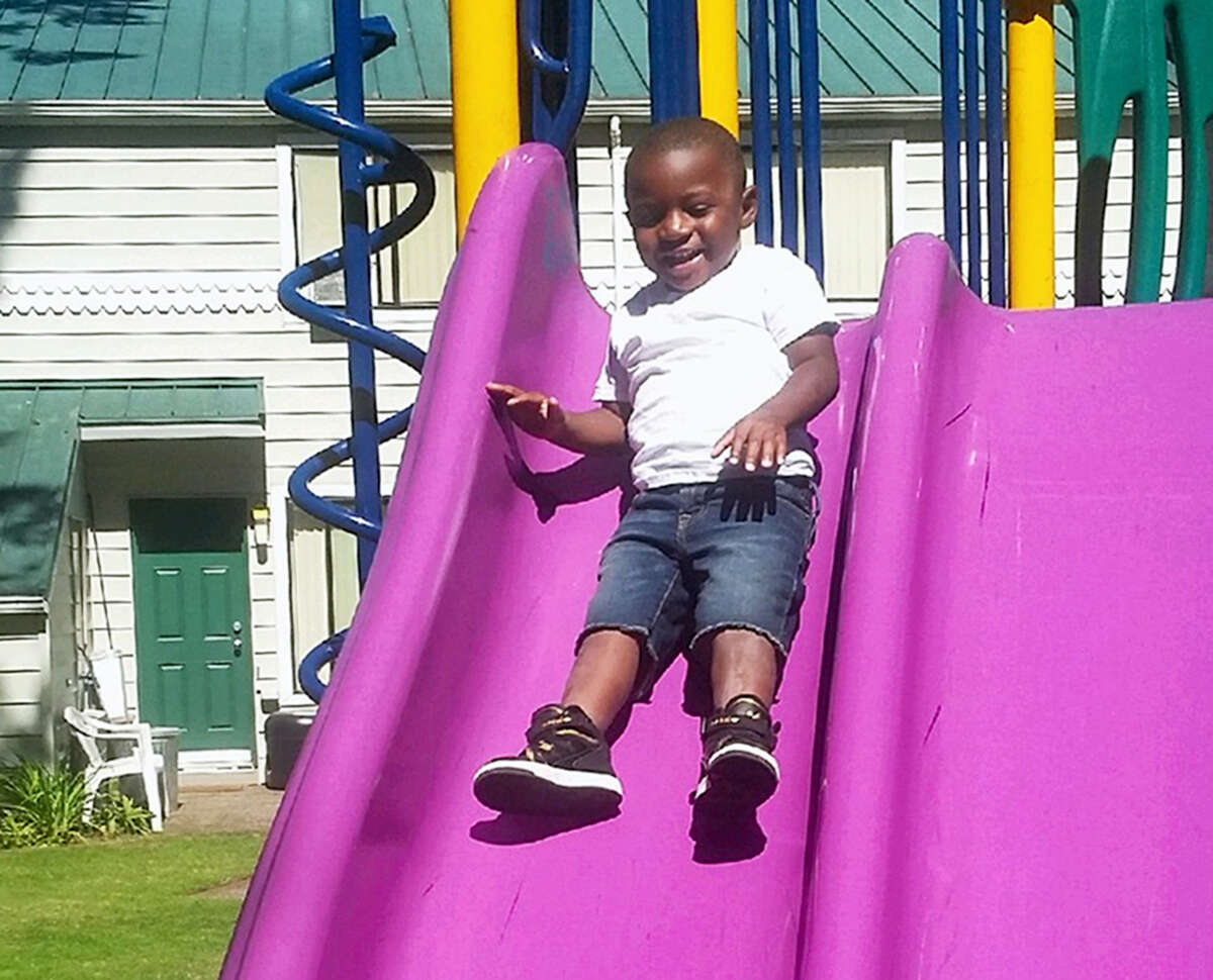 This July 2016 photo provided by Pamela Harris shows Reginald Kendall Harris Jr., playing on a slide at a park in Portland, Ore. Reginald died after swallowing methadone. His uncle has been charged in his death, accused of leaving the methadone where the boy had access to it. The number of children's deaths is still small relative to the overall toll from opioids, but toddler fatalities have climbed steadily over the last 10 years.