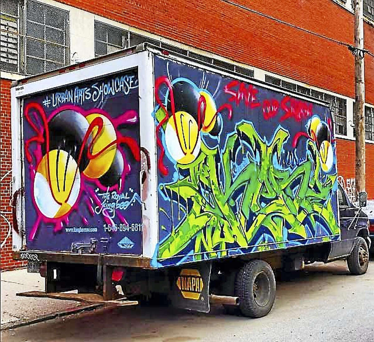Royal KingBee's work is seen on a truck.