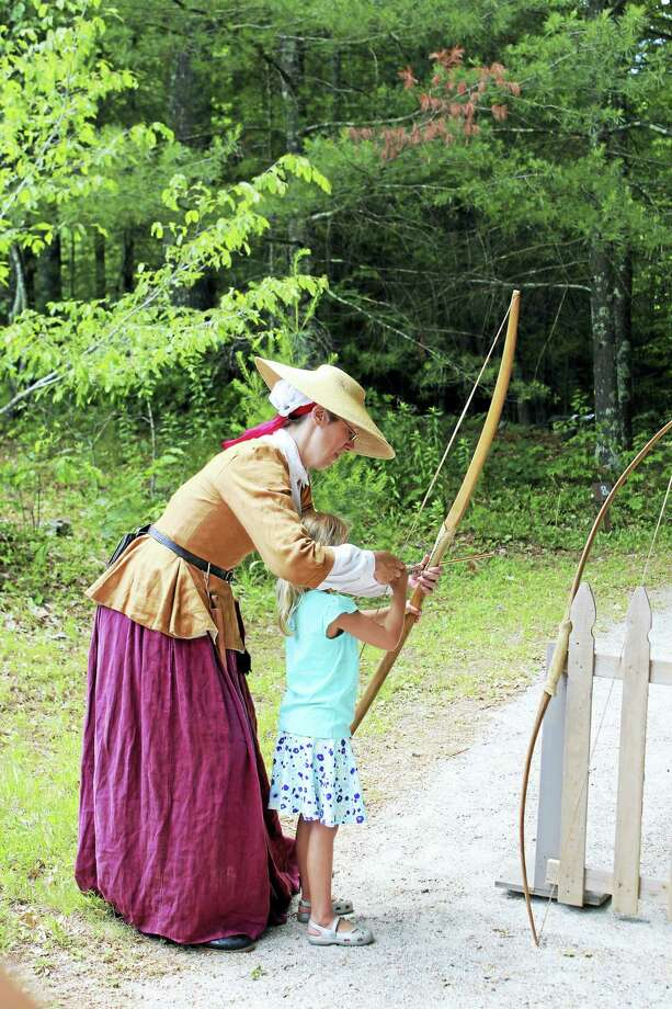 Using a bow and arrow is part of the Encampment. Photo: Photo Courtesy Of Pequot Museum