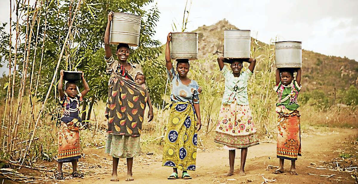 Gathering water in Africa Courtesy Water Works for Africa