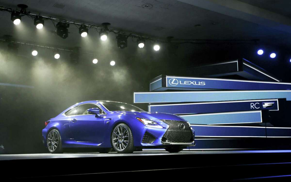 In this Jan. 14, 2014 photo, the Lexus RC F Coupe is unveiled at the at the North American International Auto Show in Detroit. Technology glitches including Bluetooth phone pairing and misunderstood voice commands dented car and truck reliability scores in a major survey of automobile owners. Lexus and Porsche tied for the top spot, leading all brands for dependability in the survey released Feb. 22, 2017 by the consulting firm J.D. Power.
