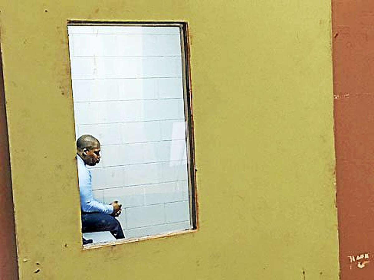 Sen. Gary Winfield, D-New Haven, sits in the replica of a solitary confinement cell for two hours Tuesday, Feb. 21, 2017.
