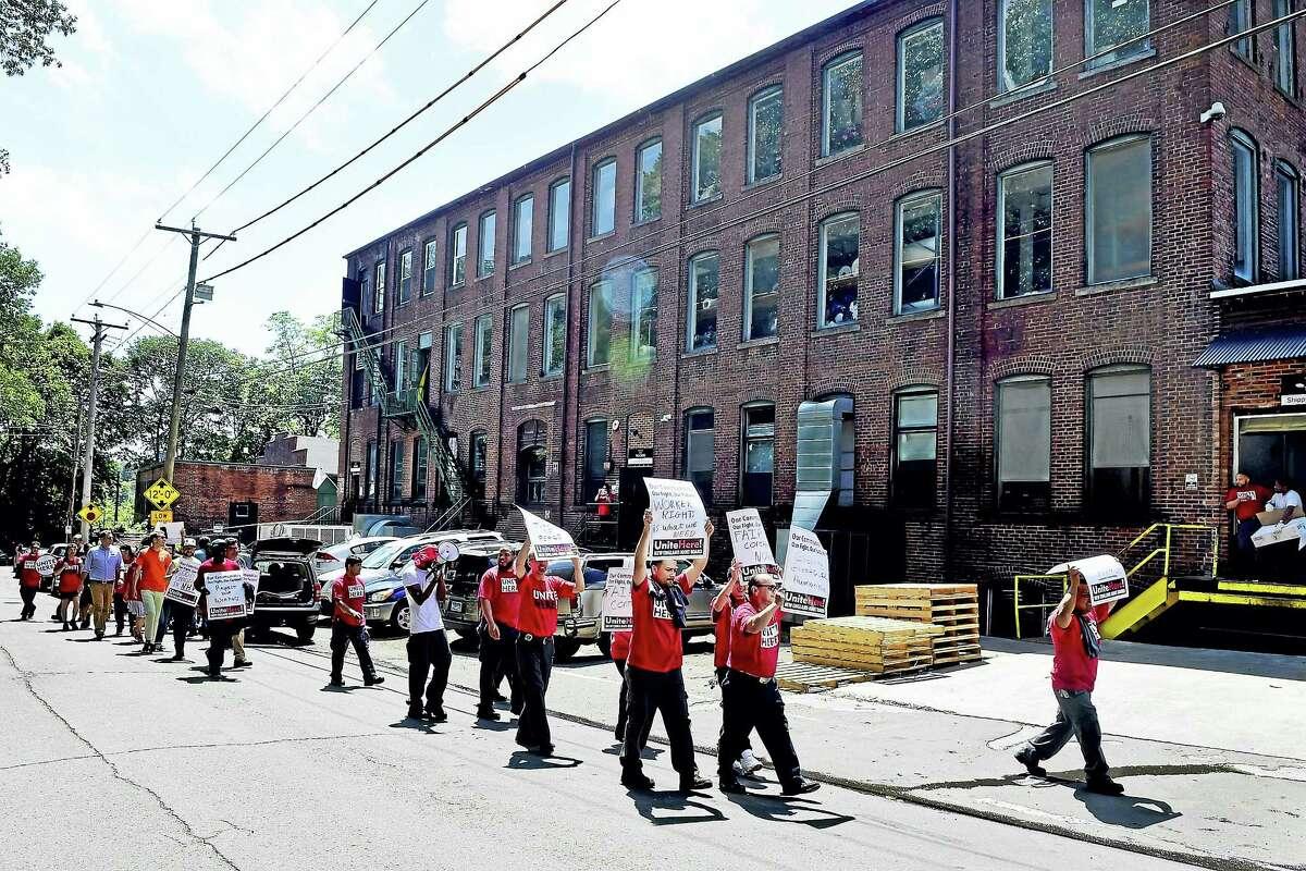 Protesters demonstrate at the Trelleborg Uretek plant on Lenox Street in New Haven Wednesday.