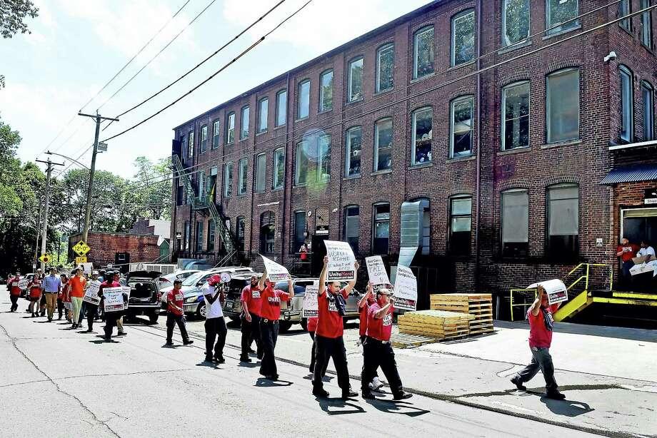 Protesters demonstrate at the Trelleborg Uretek plant on Lenox Street in New Haven Wednesday. Photo: Peter Hvizdak / Hearst Connecticut Media   / Peter Hvizdak