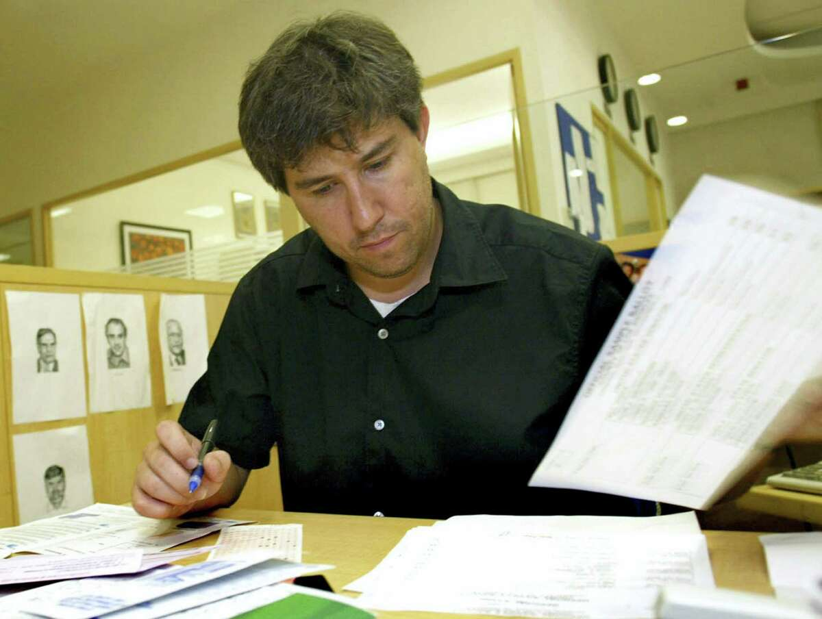 In this Thursday, Sept. 30, 2004, file photo, Wall Street Journal correspondent Jay Solomon, checks his papers as he fills his U.S. election absentee ballot at his office in New Delhi, India. The Wall Street Journal on June 21, 2017, fired Solomon, its chief foreign affairs correspondent, after evidence emerged about his involvement in prospective business deals, including one involving arms sales to foreign governments, with an international businessman who was one of his key sources. Solomon was offered a 10 percent stake in a fledgling company, Denx LLC, by Farhad Azima, an Iranian-born aviation magnate who ferried weapons for the CIA. It was not clear whether Solomon ever received money or formally accepted a stake in the company. Solomon did not immediately comment.