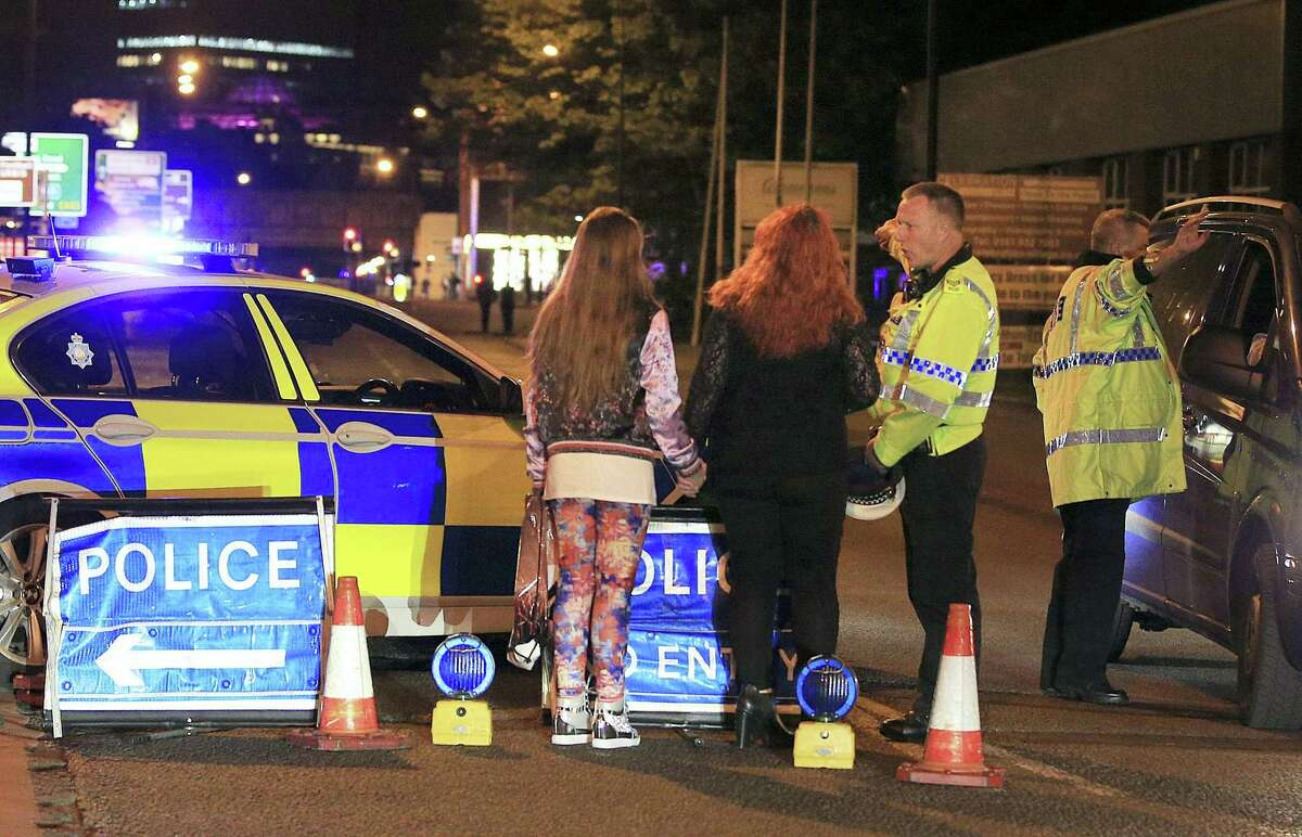 Police work at Manchester Arena after reports of an explosion at the venue during an Ariana Grande gig in Manchester, England Monday, May 22, 2017. Several people have died following reports of an explosion Monday night at an Ariana Grande concert in northern England, police said. A representative said the singer was not injured.